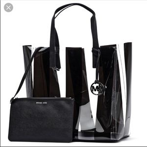 Michael Kors black/clear tote with black wristlet.